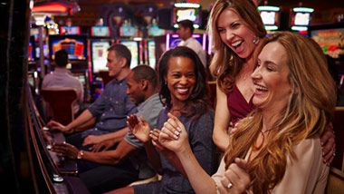 women playing slots at River City Casino